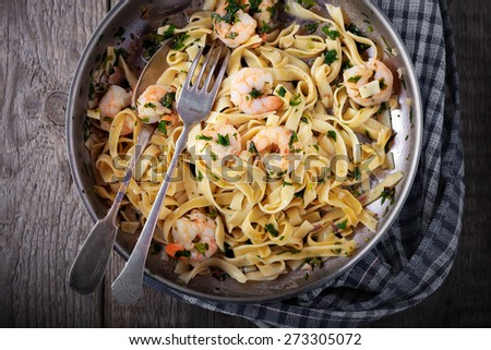 Tagliatelle with shrimps on the pan - stock photo