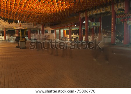 Tai chi performance in chinese temple, Malaysia - stock photo