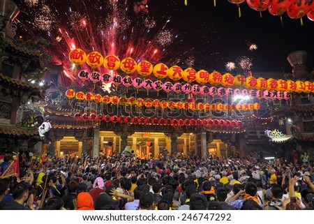TAICHUNG,TAIWAN-APRIL 6: The Dajia Matsu Pilgrimage begins on April 6, 2014 in Taichung, Taiwan. It is one of the largest religious activities in the world. - stock photo