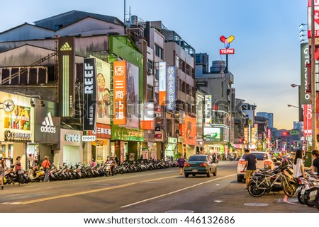 TAICHUNG, TAIWAN - AUG 30 2015: People is busy on the street in Yizhong Night Market on 30 AUG 2015. Yizhong Night Market is one of the famous night market in Taiwan.