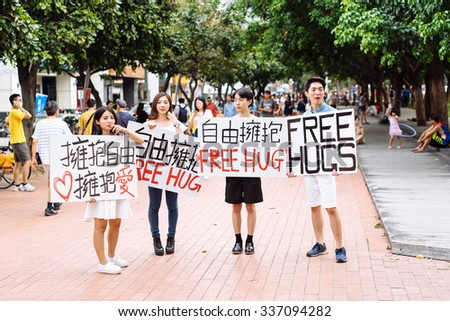 Taichung, Taiwan - July 25 2015: Offering free hugs on city street  - stock photo