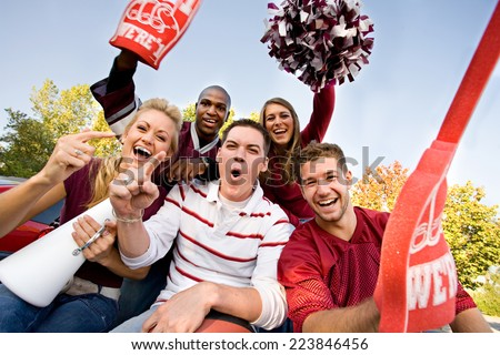 Tailgate: Group Of Fans Cheering And Yelling - stock photo