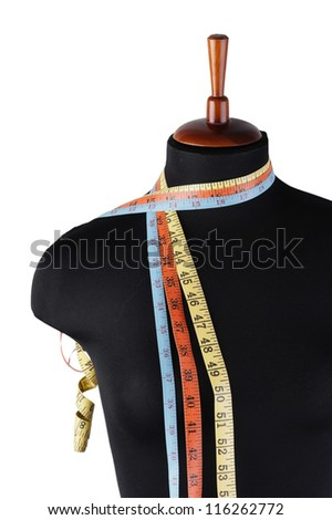 tailor meter and mannequin isolated on white background - stock photo