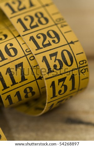 Tailor metrical measure tape detail - stock photo
