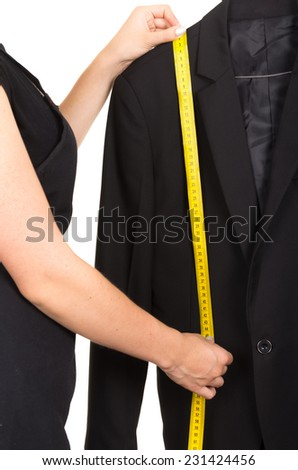 tailor's hand measuring a black suit isolated on white - stock photo