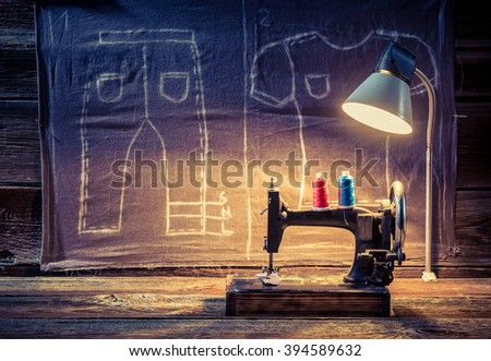 Tailor workshop with sewing machine and cloth - stock photo