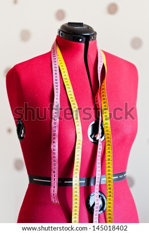 tailors dummy bust with two measure tapes - stock photo
