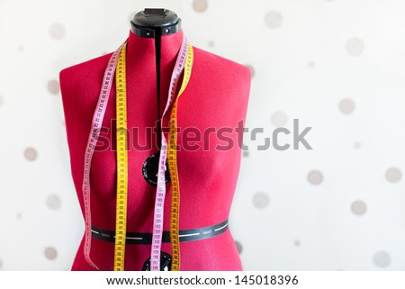 tailors model dummy with two measure tapes - stock photo