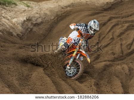 TAIN, ROSS AND CROMARTY, SCOTLAND - 9 MARCH: This is a Motocross party at Round 1 of the SMFX at the Tain Motocross Track, Scotland, United Kingdom. This event is open to public viewing. - stock photo