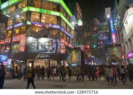 """TAIPEI - FEBRUARY 14; Advertisements for  """"Jack the Giant Slayer"""" movie. People walking in pedestrian street with many cinemas in Xiamen quarter in Taipei.  Night time. February 14, 2013 in Taipei - stock photo"""