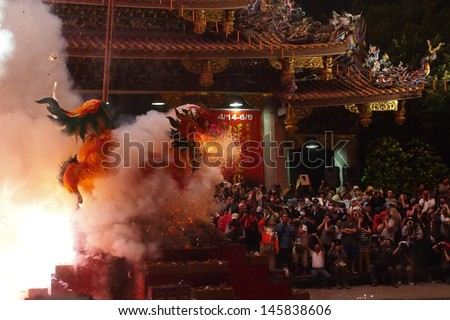 TAIPEI, TAIWAN-APRIL 23: Baosheng cultural festival is hosted for the birthday of the Baosheng Emperor on April 23, 2013 in Taipei, Taiwan. A paper-made lion is fired during the ceremony.  - stock photo