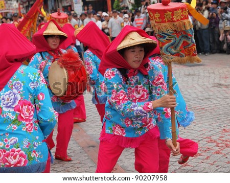 TAIPEI, TAIWAN - APRIL  16: The performance of Flower Drum Formation from Tapu in Yunlin  in a temple fair in Taipei, Taiwan on April 16, 2011. - stock photo