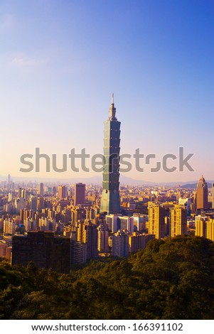 TAIPEI, TAIWAN - AUGUST 19: A view to Taipei 101 from busy corner in Xinyi financial district of Taipei city AUGUST 19, 2013 in Taipei, TW. The building is the world's second tallest at 509 meters. - stock photo