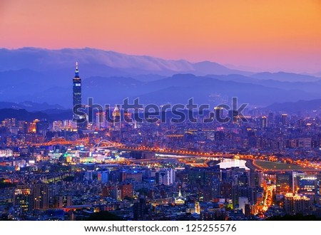 Taipei, Taiwan famed cityscape with mountains in the background. - stock photo