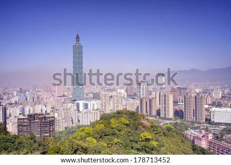 TAIPEI, TAIWAN - FEBRUARY 25: Taipei skyline on February 25, 2014 in Taipei, Taiwan. The city is under heavy air pollution and dusty.  It is a hazy sunny day.   - stock photo