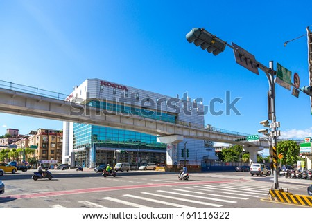 Taipei, Taiwan - July 14th 2016 - Car and buses in a donwtone Taipei in a blue sky day in Taiwan, Asia.