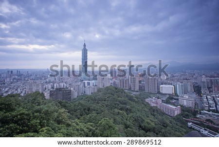 TAIPEI, TAIWAN - JUN 14 : Sunset hours in Taipei on June 14, 2015, Taipei is the capital city of Taiwan. Taipei 101 is the landmark skyscraper the second tallest building in the world. - stock photo