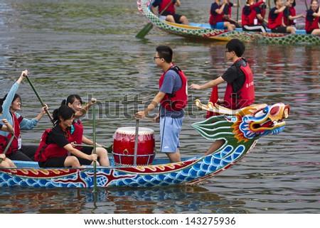 TAIPEI, TAIWAN-JUNE 9,2013:dragonboat teams racing during the 2013 Taipei Dragon Boat festival on JUNE 9,2013 in Taipei,Taiwan - stock photo