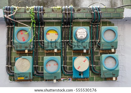Taipei,Taiwan - March 14,2015 : Some old building in Taiwan still using this vintage Analog Electricity Meters.
