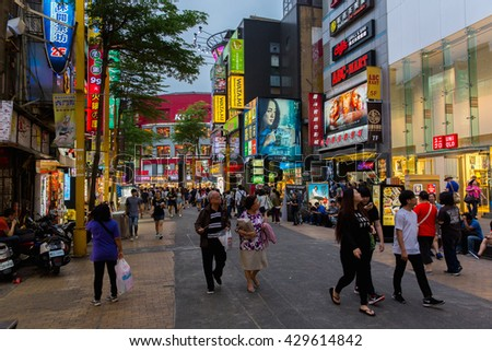 TAIPEI, TAIWAN - May 4 : Locals and tourists walking at the Ximending street market in Taipei, Taiwan on May 4, 2016 .This street is the gathering place for youngster in Taipei.