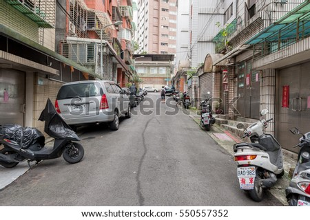 TAIPEI, TAIWAN - NOVEMBER 30, 2016: Taipei Street in one of suburb, district. Scooters and House in Background.