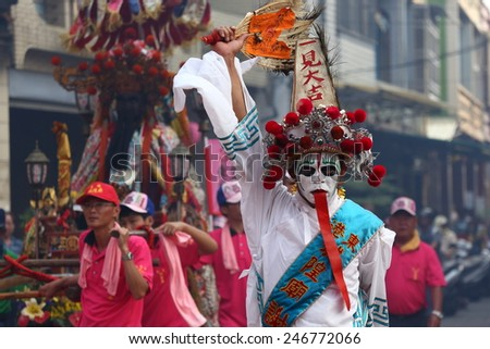 TAIPEI, TAIWAN-OCTOBER 1: The parade of Matsu is host on October 1, 2014 in Pingtung, Taiwan. A disciple of DongFu Temple plays the Infernal General in the parade. - stock photo