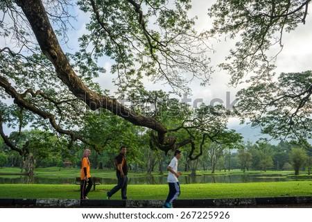 TAIPING PERAK, MALAYSIA - 7 APRIL 2015: People jogging and doing morning jogging at Lake Taiping. The first recreational lake in Malaysia - stock photo