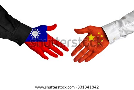 Taiwan and China leaders shaking hands on a deal agreement - stock photo
