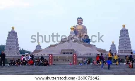 Taiwan Kaohsiung - February 23, 2015: Sunset Kaohsiung, Taiwan, there are a lot of tourists walking Fo Guang Shan Buddhist Temple. - stock photo
