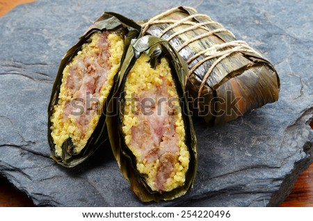Taiwan's aboriginal traditional food made with millet rice & pork wrapped in leaves - stock photo