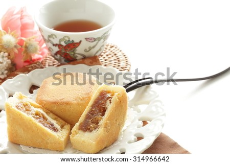 Taiwanese food, pineapple pie and tea with Chinese tea on background - stock photo