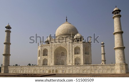 Taj Mahal stands out against blue sky in Agra, India. It was built by Mughal emperor Shah Jahan in memory of his third wife, Mumtaz Mahal