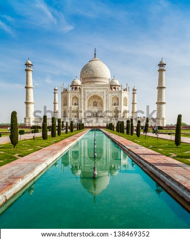 Taj Mahal with reflection in water - stock photo