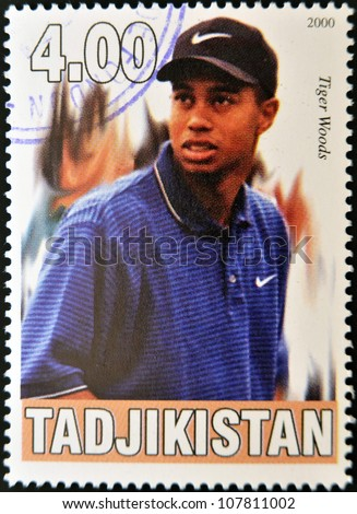 TAJIKISTAN - CIRCA 2000: A stamp printed in Tajikistan shows Tiger Woods, circa 2000 - stock photo