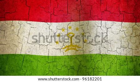 Tajikistan flag on a cracked grunge background - stock photo