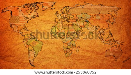 tajikistan flag on old vintage world map with national borders