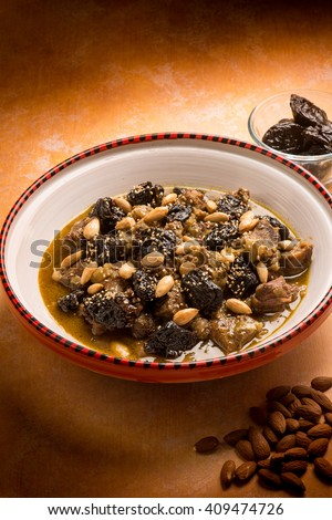 tajine with meat plum almond and sesame seeds - stock photo
