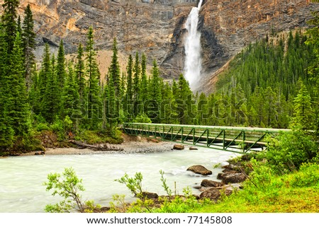 Takakkaw Falls waterfall and footbridge in Yoho National Park, British Columbia, Canada - stock photo