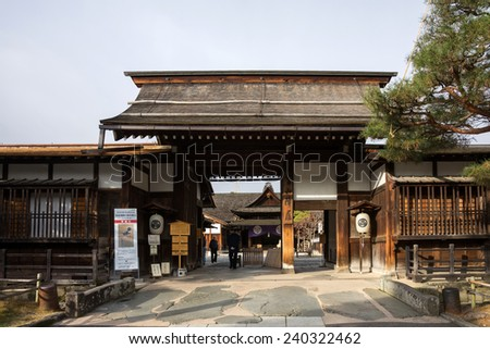 TAKAYAMA, JAPAN - DECEMBER 03, 2014: View of Takayama Jinya house shows the exterior and gardens. It is the home of the governor of Hida province build in 1692, is the oldest surviving house in Japan. - stock photo