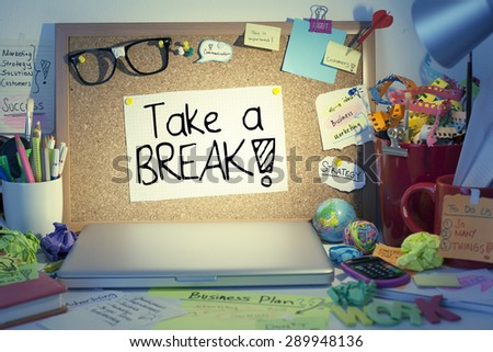 Take a break note on bulletin board in office / Overloaded worker needs break or day off concept - stock photo