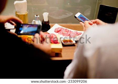 take a food picture for instagram - stock photo
