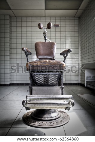Take a seat... An old anxious dentist chair at an abandoned hospital, waiting for the next victim... - stock photo