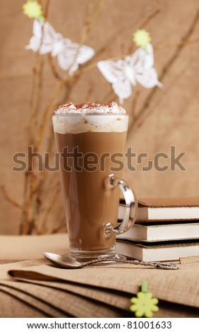 take a spring break with coffee!,coffee latte glass with diaries and flower pegs, shallow dof - stock photo