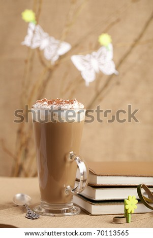 take a spring break with coffee!,coffee lattee glass with diaries and flower pegs, shallow dof - stock photo