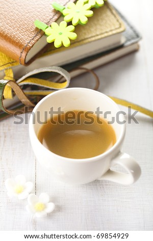 take a spring break with coffee!, espresso coffee cup with diaries and flower pegs, shallow dof - stock photo