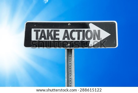 Take Action direction sign with a beautiful day - stock photo