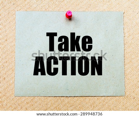 Take Action written on paper note pinned with red thumbtack on wooden board. Motivation conceptual Image - stock photo