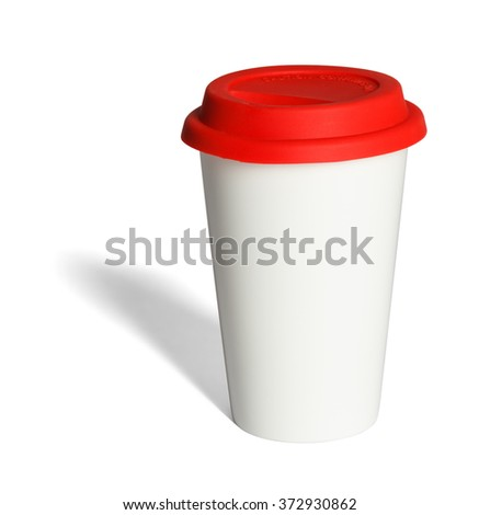 Take-out coffee in thermo cup with red silicone lid isolated on a white background - stock photo