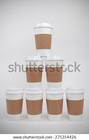 Take out paper cups with lids and holders, stacked up - stock photo