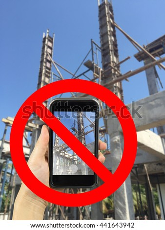 take photography with smart phone concrete in under construction with prohibit sign - stock photo